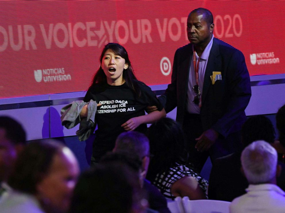PHOTO: A protester is escorted during the third Democratic primary debate of the 2020 presidential campaign season in Houston, Sept. 12, 2019.