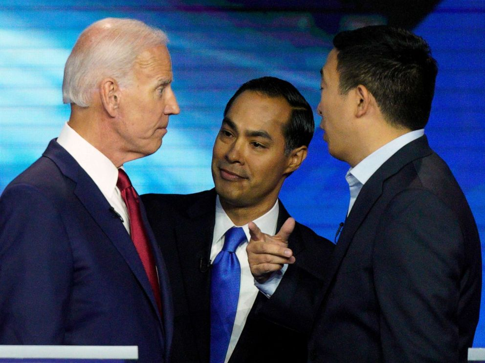 PHOTO: Democratic presidential candidates former Vice President Joe Biden, former Housing and Urban Development Secretary Julian Castro, and Andrew Yang talk Thursday, Sept. 12, 2019, after a Democratic presidential primary debate in Houston.