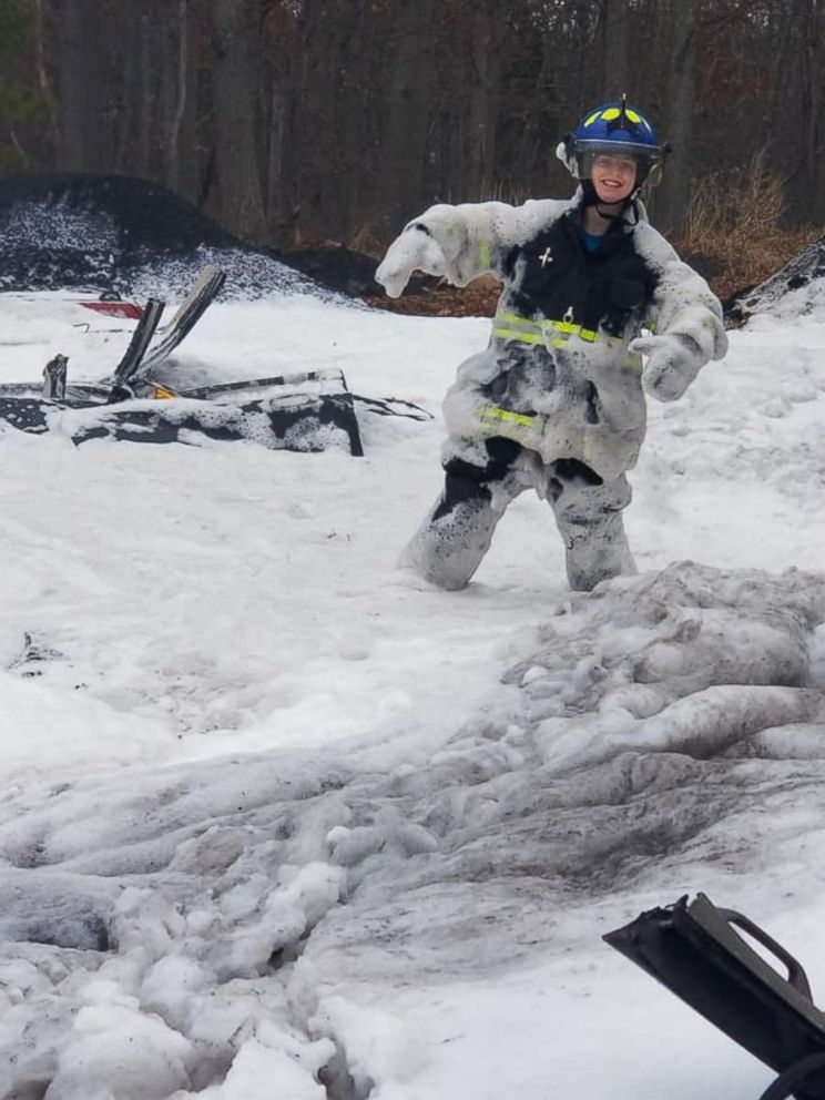 PHOTO: Natalie Dempsey, 21, who worked for the Mizpah Volunteer Fire Company 18-2, was killed responding to a fire on Christmas morning. She poses for an undated photo covered in firefighting foam.