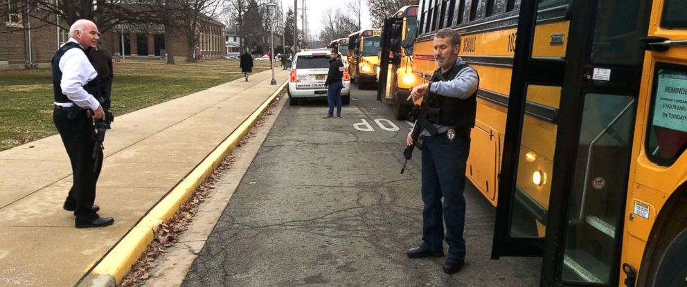 PHOTO: Buses wait to take students to Civic Hall at Richmond High School for parents to pick them up after a report of shots being fired at Dennis Intermediate School in Richmond, Ind., Dec.13, 2018.