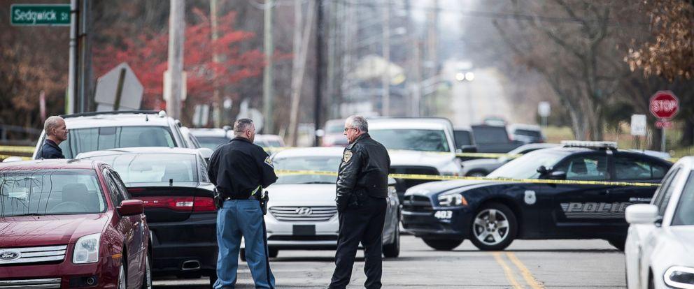 PHOTO: Police work a crime scene at Dennis Intermediate School at Richmond, Ind., Dec. 13, 2018.