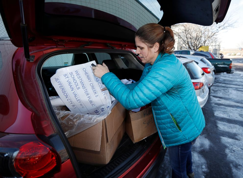 PHOTO: Kate Martin, a former teacher and current employee of the Denver Classroom Teachers Association, unloads items for a potential teachers strike outside the unions headquarters in south Denver, Jan. 17, 2019.