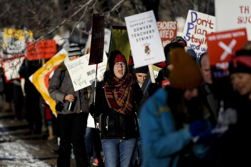 PHOTO: South High School ninth grade teacher Tessa Zatorski, left, chants while picketing outside South High School, Feb. 11, 2019 in Denver.
