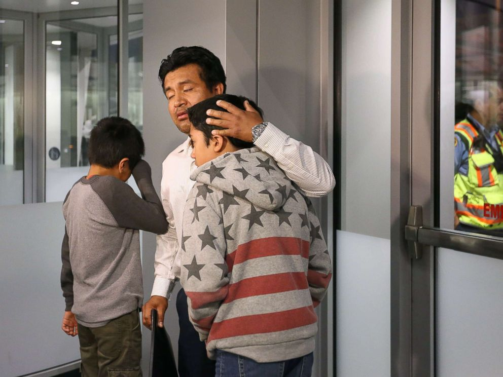 PHOTO: Jesus Lara Lopez, 37, of Willard, Ohio, comforts his sons before he is deported back to Mexico, July 18, at Cleveland Hopkins International Airport.