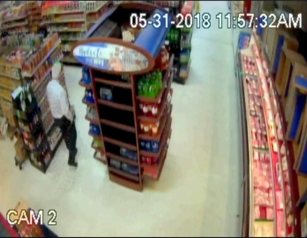 PHOTO: A Florida sheriffs deputy threw a couple cans at a suspect in a grocery store to disarm him after he was threatening and swinging at people with a hammer.