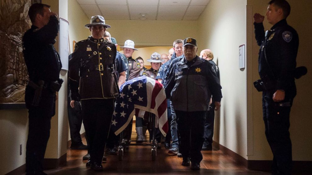 Officers and medical staff take part in a procession for officer Daniel McCartney, of Yelm, at St. Joseph Medical Center in Tacoma, Wash., Jan. 8, 2018.