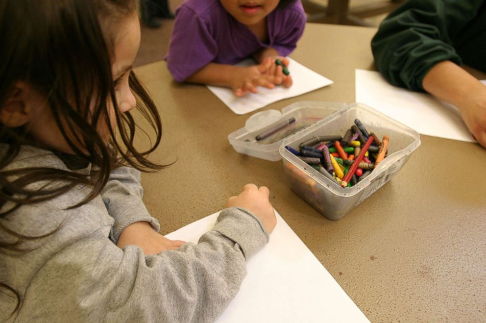 PHOTO: Children of immigrant families color at the T. Don Hutto Residential Center in Taylor, Texas.