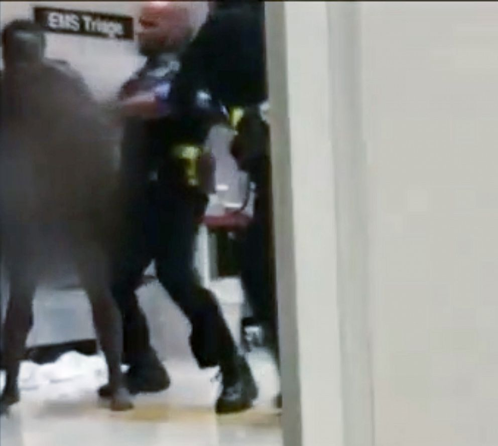 PHOTO: An image made from cell-phone video appears to show a Detroit police officer punching a naked and apparently emotionally disturbed woman at Detroit Receiving Hospital, Aug. 1, 2018.