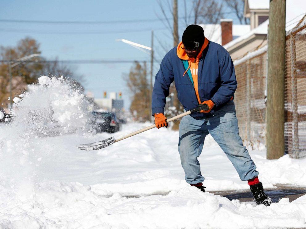 PHOTO: Kevin Strickland shovels snow from a sidewalk in Detroit, Michigan, Nov. 12, 2019.