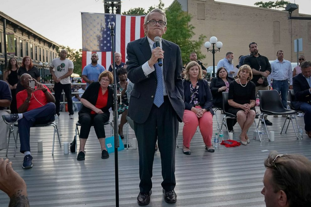 PHOTO: Ohio Governor Mike DeWine reacts as vigil attendees shout, Do Something while he was speaking at a vigil at the scene after a mass shooting in Dayton, Ohio, Aug. 4, 2019.