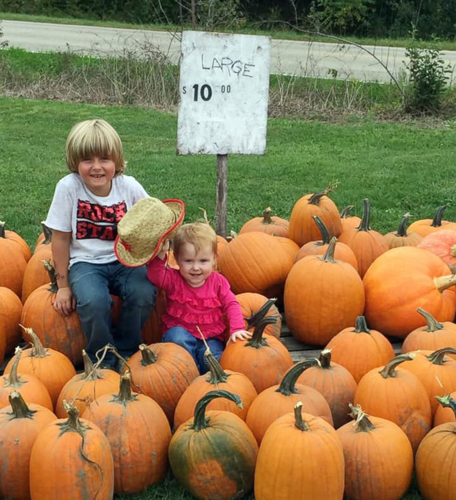 PHOTO: 6-year-old Ian Christensen who suffers from type 1 diabetes poses for a photo with his younger sister while selling pumpkins outside his home in Sand Lake, Mich., in hopes of raising money to buy an alert dog that can help him with his disease.