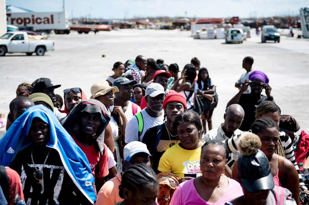 PHOTO: People await evacuation by boat at the port after Hurricane Dorian, Sept. 7, 2019, in Marsh Harbor, Great Abaco.