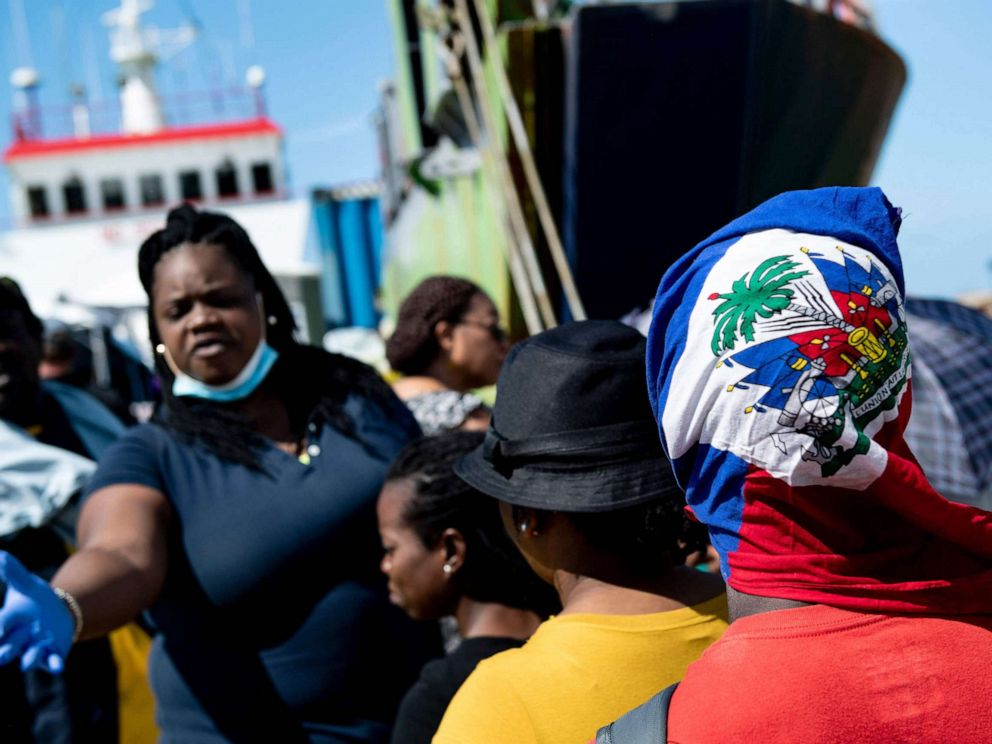 PHOTO: People board a cargo ship for evacuation to Nassau at the port in Marsh Harbour, Great Abaco, Sept. 7, 2019, in the aftermath of Hurricane Dorian.