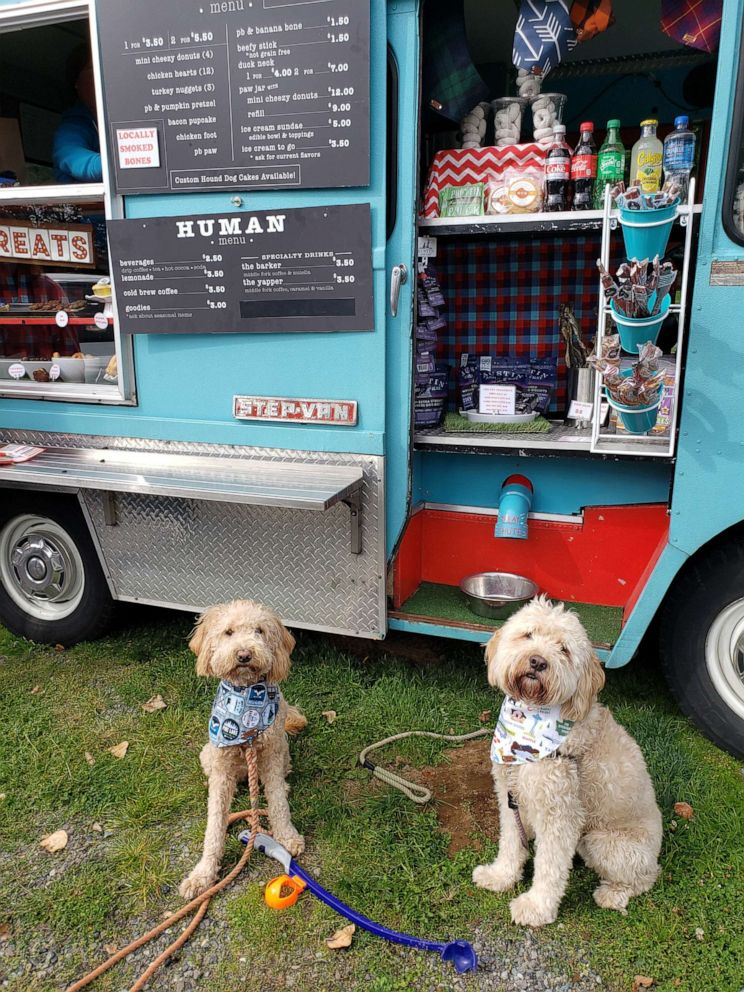 PHOTO: Seattle resident Molly Oberndorf and her two Goldendoodles, Moose and Nellie, love the bakery items for sale at the dog food truck. The pups favorites include beefy sticks and bacon birthfay cakes.