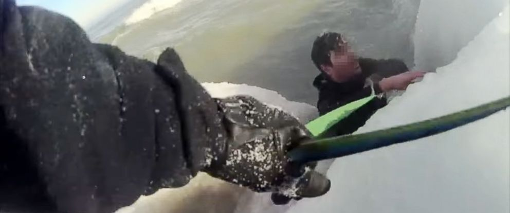 PHOTO: Chicago police rescue a man trapped in Lake Michigan after he jumped in to rescue his puppy, Jan. 27, 2019.