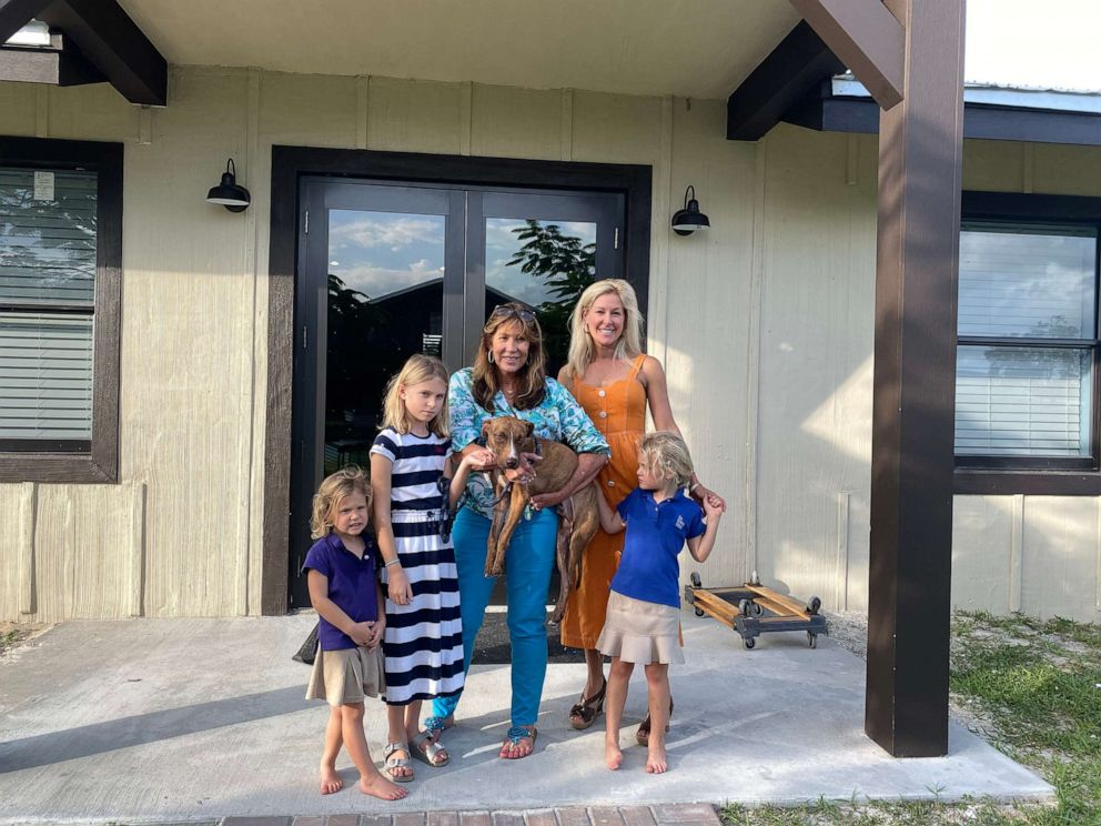 PHOTO: Clare Beaty, Jayne Beaty, Big Dog Ranch Rescue founder/president Lauree Simmons; mother Briana Beaty; and Kate Beaty take a photo with Miracle.