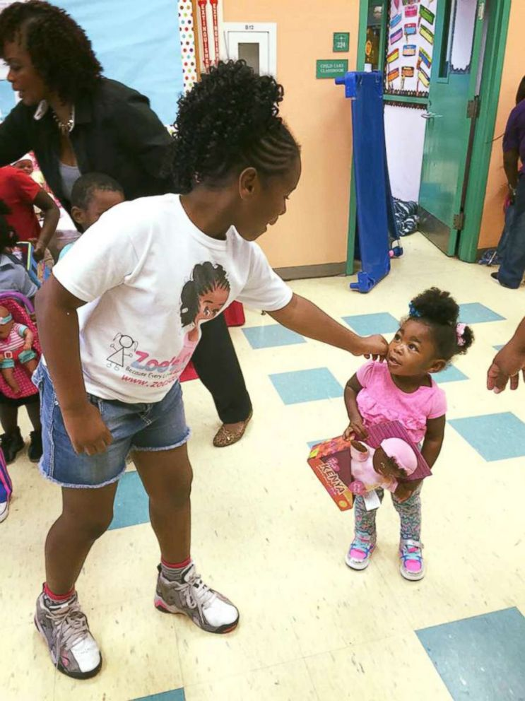 PHOTO: Zoe Terry, 11, is photographed here with young girls who have received dolls of color through her nonprofit group Zoes Dolls at one of their giveaway events.