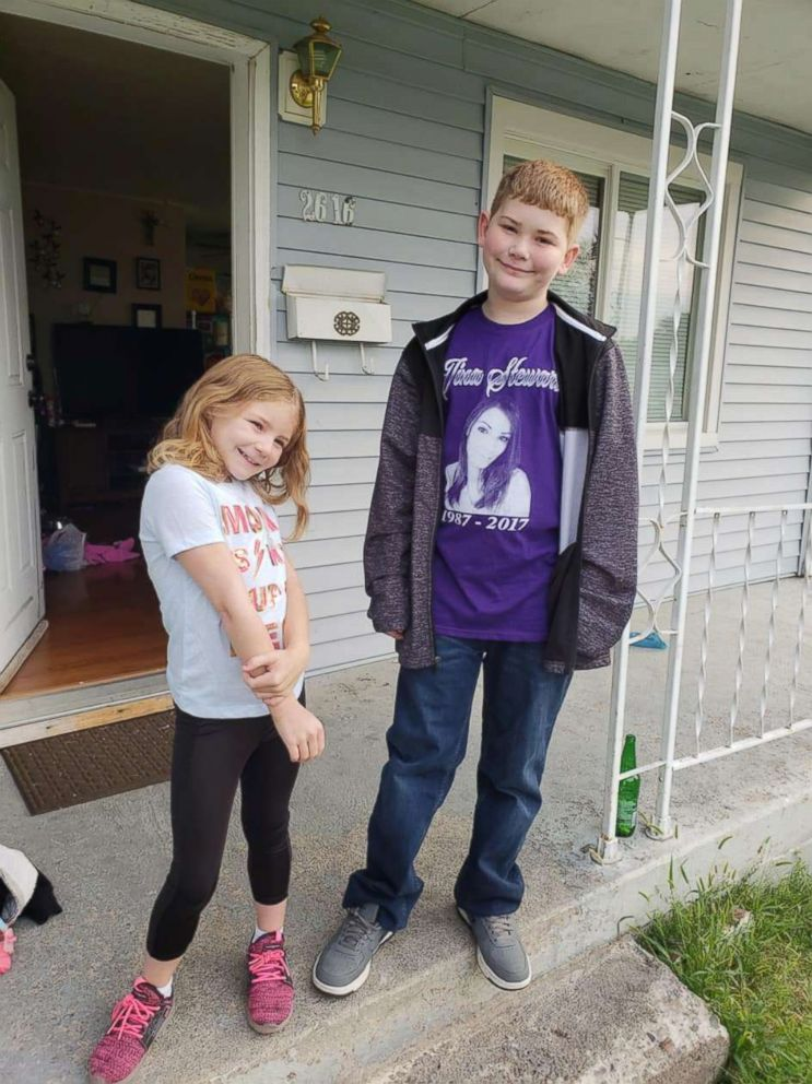 PHOTO: Tina Stewarts children, Addy, 8, and Shane, 12, remember their mother who was murdered in a domestic violence incident. Share wears a t-shirt with his mothers picture on it.