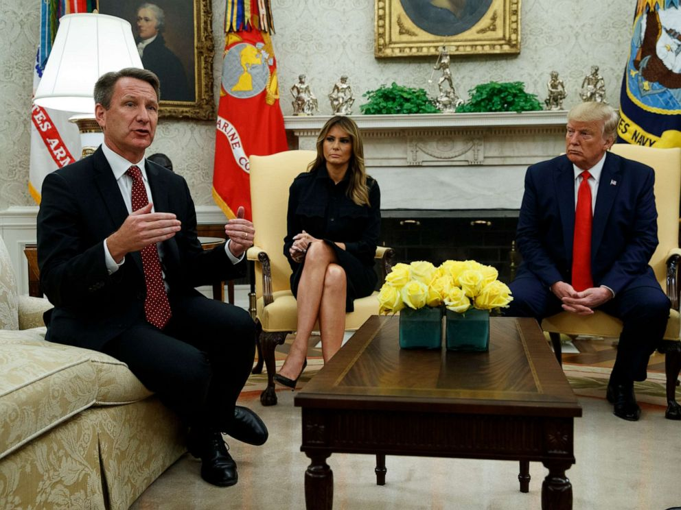 PHOTO: President Donald Trump and first lady Melania Trump listen as acting FDA Commissioner Ned Sharpless talks about a plan to ban most flavored e-cigarettes, in the Oval Office of the White House, Sept. 11, 2019, in Washington.