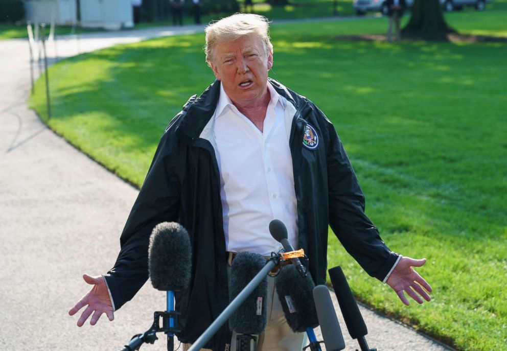 PHOTO: President Donald Trump speaks to the media before boarding Marine One on the South Lawn of the White House in Washington, Sept. 19, 2018.