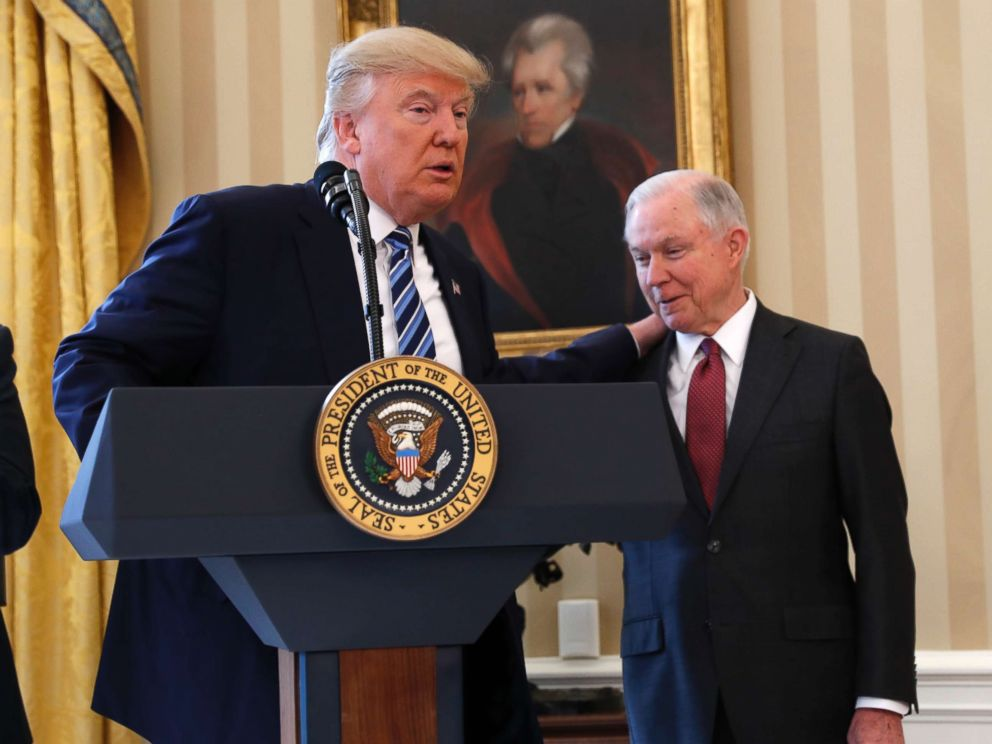 PHOTO: President Donald Trump talks to Attorney General Jeff Sessions in the Oval Office of the White House in Washington, Feb. 9, 2017, before Vice President Mike Pence administered the oath of office to Sessions.