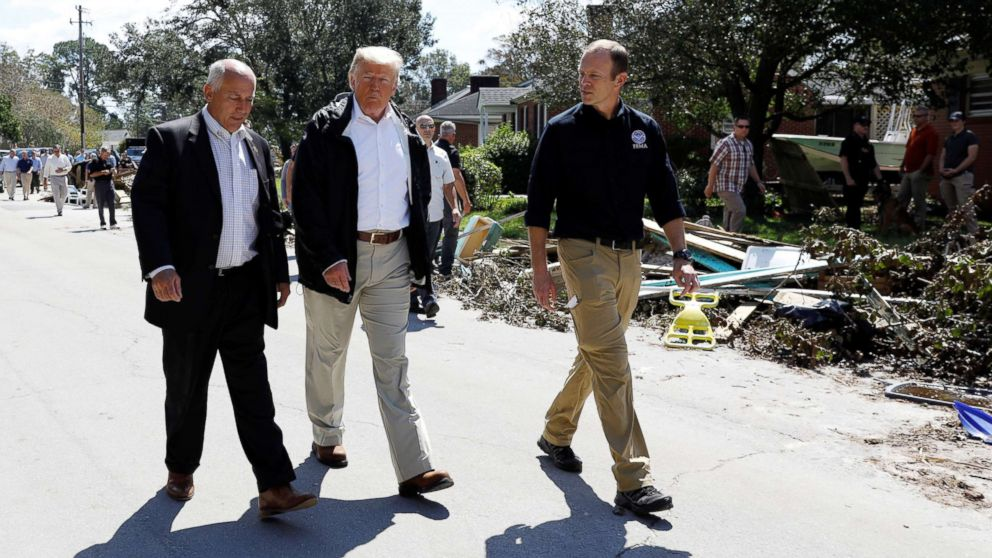 President Donald Trump walks down a street while on a tour of Hurricane Florence recovery efforts in New Bern, N.C., Sept. 19, 2018.