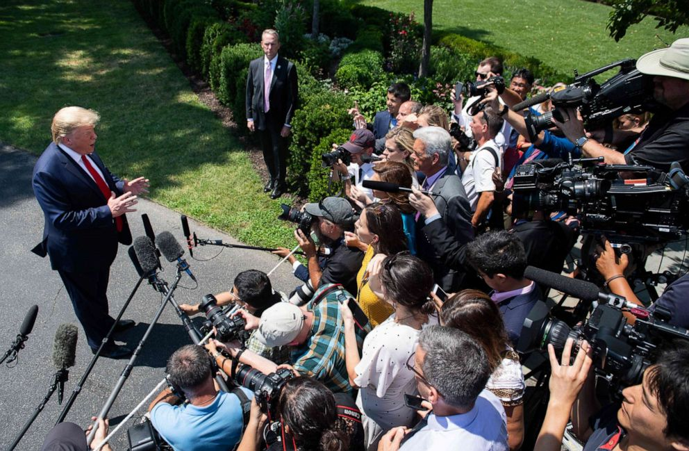 PHOTO: President Donald Trump speaks to the media after arriving on the South Lawn of the White House in Washington, July 30, 2019.