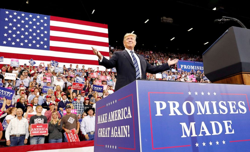 "President Donald Trump greets the crowd as he arrives for his ""Make America Great Again"" rally in Billings, Mont., Sept. 6, 20"