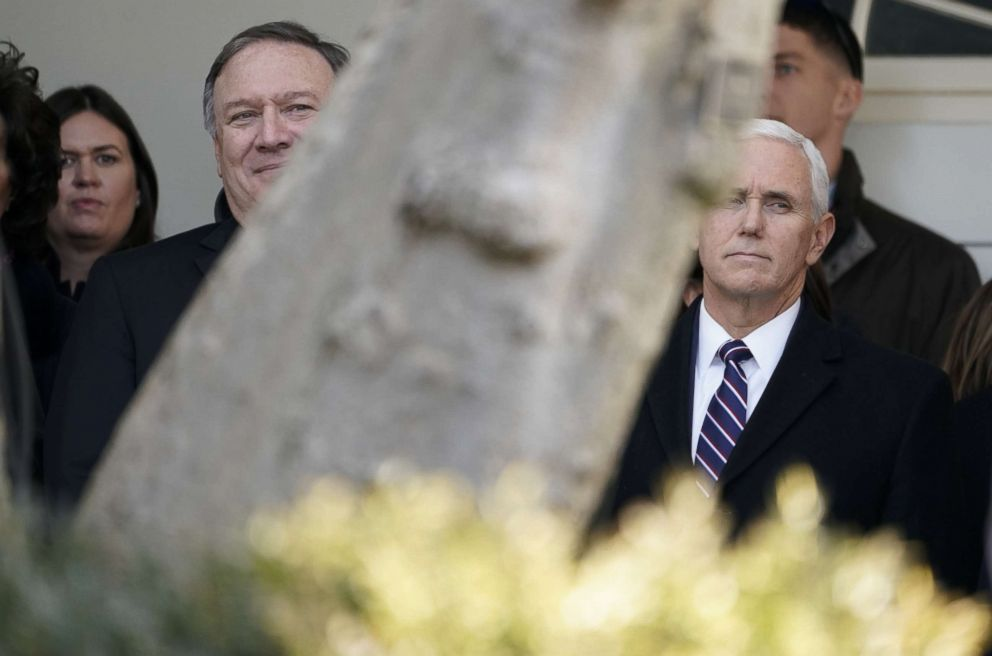White House press secretary Sarah Huckabee Sanders, Secretary of State Mike Pompeo and Vice President Mike Pence listen to President Donald Trump announce a deal to end the partial government shutdown in the Rose Garden of the White House, Jan. 25, 2019.
