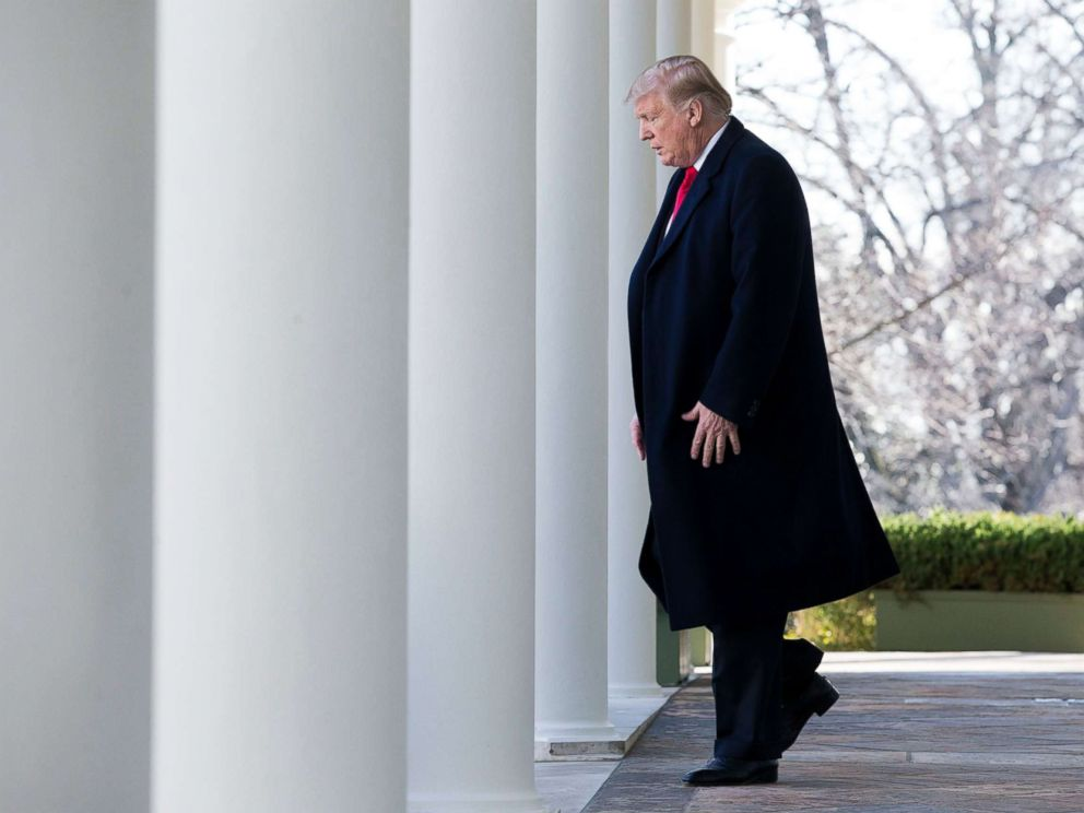 PHOTO: President Donald Trump walks down the Colonnade to deliver remarks on ending the partial shutdown of the federal government, in the Rose Garden of the White House in Washington, Jan. 25, 2019.
