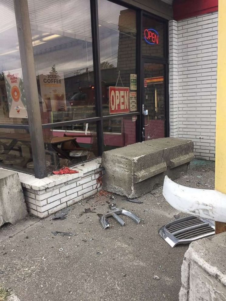 The wreckage in front of a donut shop after a driver was arrested for DUI on Friday, June 8, 2018, when he slammed into the front of the store in Auburn, Washington.  Video shows truck plow into donut shop at full speed, narrowly missing customers donut shop crash2 ho mo 20180609 hpEmbed 3x4 992