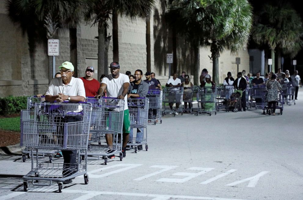 PHOTO: Shoppers wait in a long line for a Sams Club store to open before sunrise, as people rushed to buy supplies ahead of the arrival of Hurricane Dorian in Kissimmee, Florida, U.S. August 30, 2019.