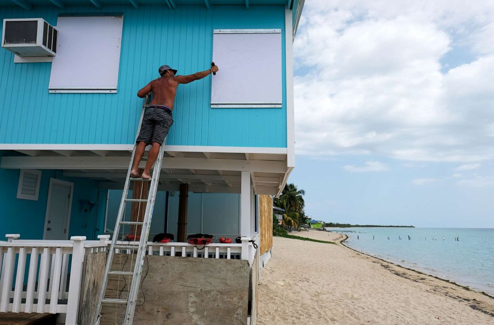 PHOTO: A man boards up a window of a beach house in the tourist zone of El Combate as Tropical Storm Dorian approaches in Cabo Rojo, Puerto Rico, Aug. 27, 2019.