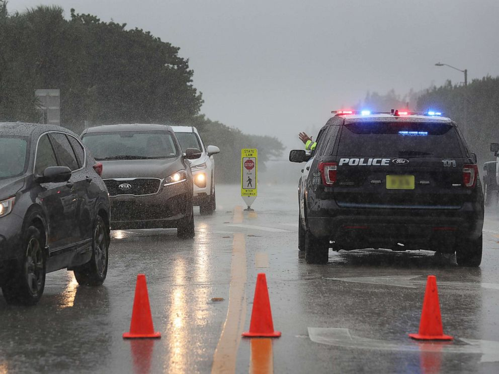 PHOTO: A Highland Beach police officer sits in his vehicle to check ids of people in cars as he only allows residents to enter the Highland Beach area as Hurricane Dorian continues to make its way toward the Florida coast, Sept. 2, 2019.