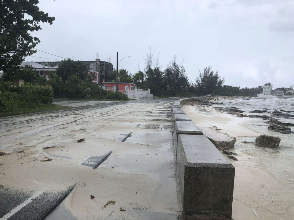 PHOTO: Sand pours on to a road near the beach during the approach of Hurricane Dorian, Sept. 1, 2019, in Nassau, Bahamas.
