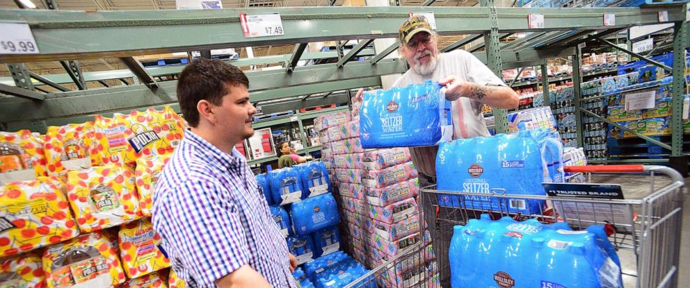 PHOTO: Residents Al-Muthanna Al-Ani (L) and Lloyd Strickland buy supplies in preparation for Hurricane Dorian at BJs store, Aug. 29, 2019, in Orlando, Fla.