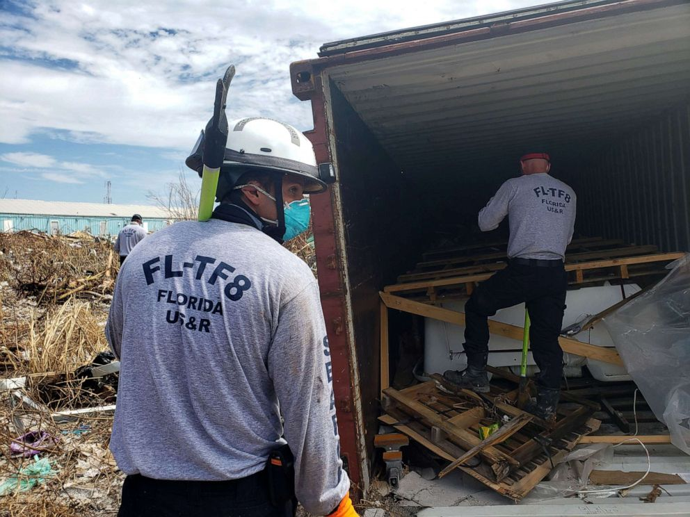 PHOTO: Florida fire Lieutenant and search and rescue volunteer Chad Belger leads a search for the dead in the destroyed Abaco shantytown called Pigeon Peas, after Hurricane Dorian in Marsh Harbour, Bahamas, Sept. 8, 2019.