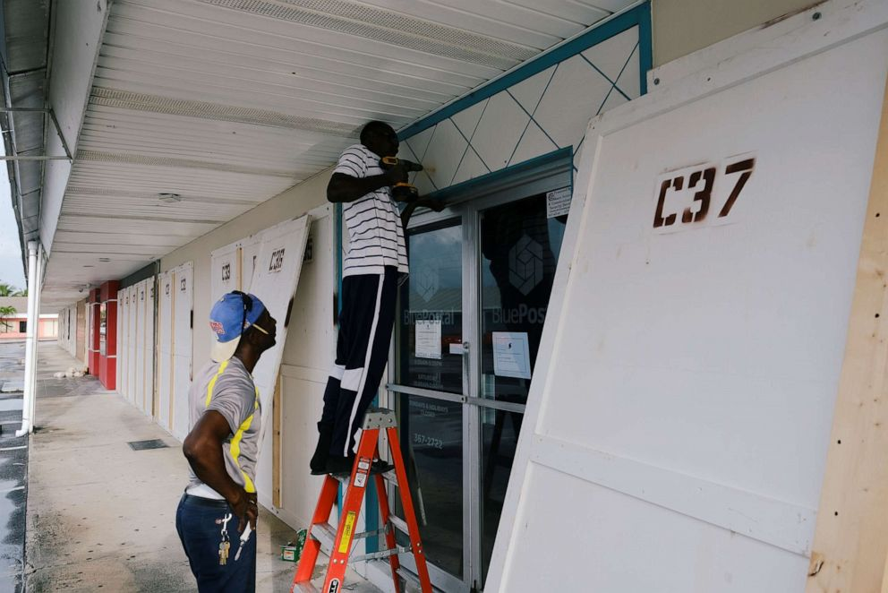 PHOTO: Workers install storm shutters before the arrival of Hurricane Dorian in Marsh Harbour, on the Great Abaco Island, Bahamas, August 31, 2019.