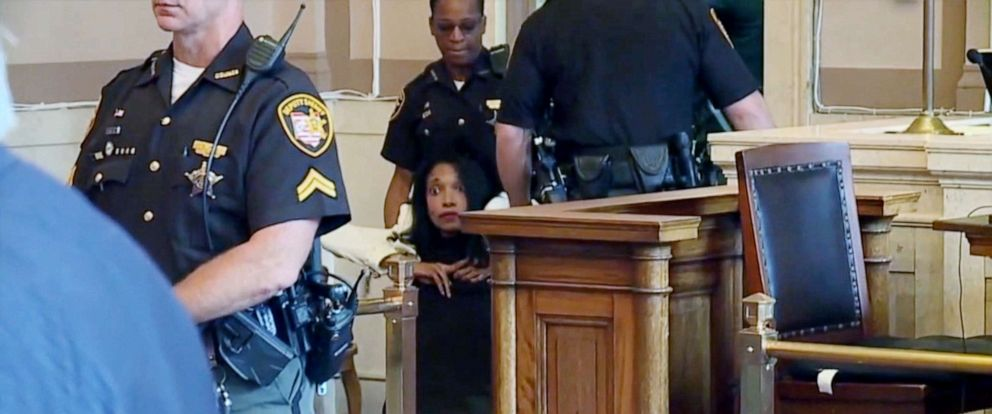 PHOTO: Former juvenile court judge Tracie Hunter is dragged from court, July 22, 2019, after sentencing in Cincinnati.