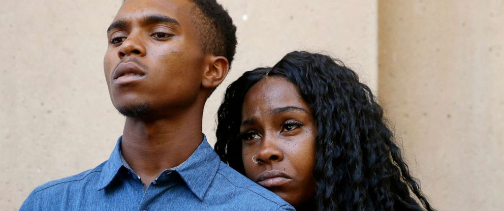 PHOTO: Dravon Ames, left, and Iesha Harper listen to a question during a news conference at Phoenix City Hall, June 17, 2019, in Phoenix.