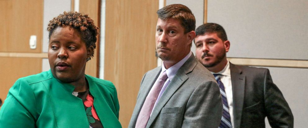 PHOTO: Defense attorney Theresa Jean-Pierre Coy, defendant Michael Drejka, and defense attorney William Flores wait to leave the courtroom before a break, Thursday, August 22, 2019 during Drejkas manslaughter trial in Pinellas County.