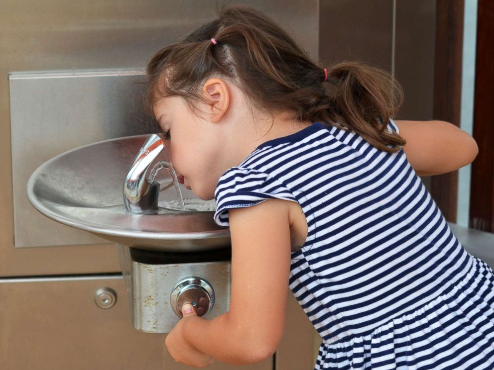 PHOTO: A girl drinks from a water fountain in an undated stock photo.