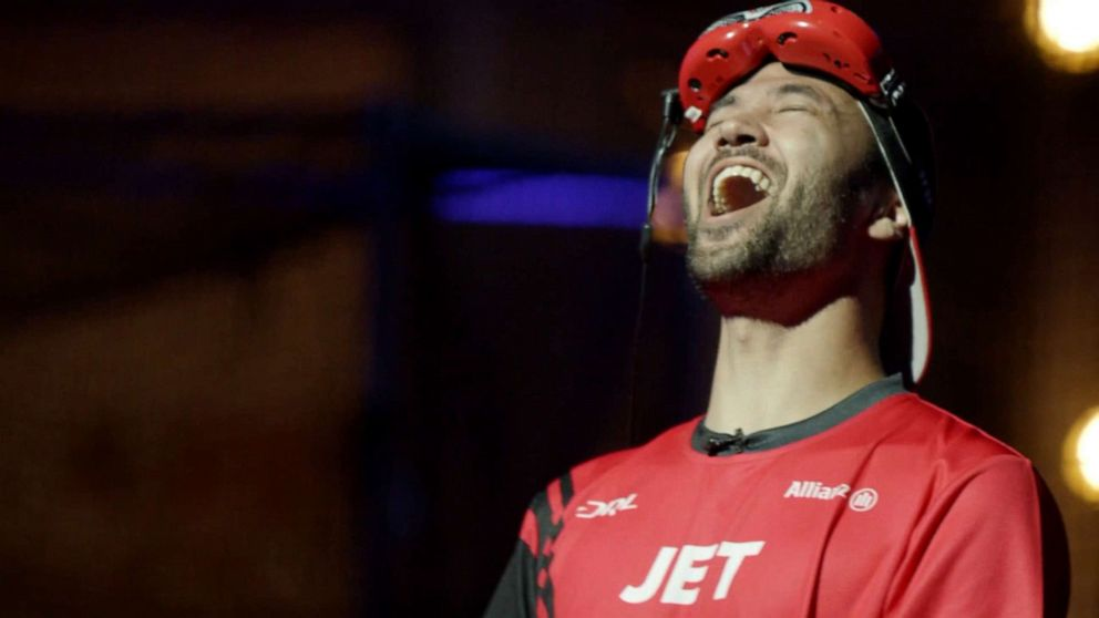 PHOTO: Professional DRL drone racer Jordan JET Temkin throws his head back in disappointment after losing a race.