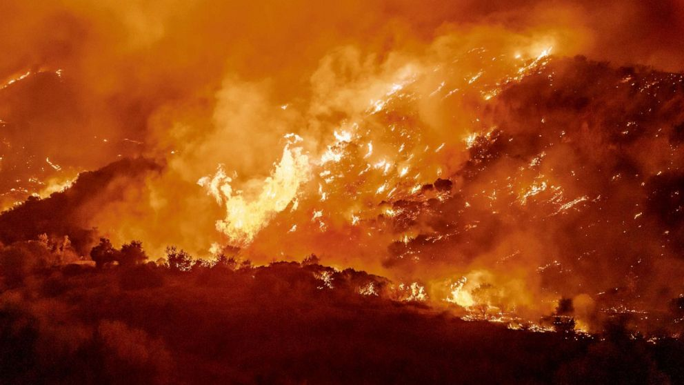 PHOTO: The Bond Fire driven by high winds burns the hillsides west of Santiago Canyon Road near Silverado Canyon, Calif., Dec. 3, 2020.
