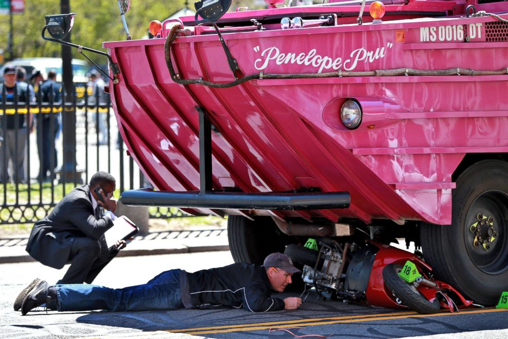 PHOTO: Investigators work the scene of an accident involving a Duck Boat, April 30, 2016, in Boston. A woman was killed after the scooter she was driving was struck by an amphibious sightseeing vehicle in downtown Boston.