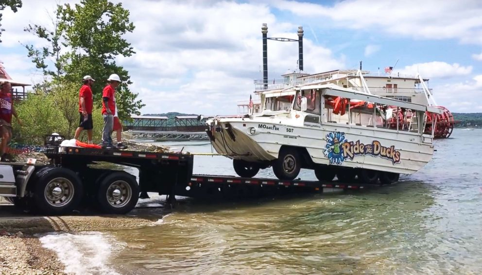 Investigators remove the duck boat on July 23, 2018, from Table Rock Lake near Branson, Mo., five days after it capsized in a storm killing 17 passengers.