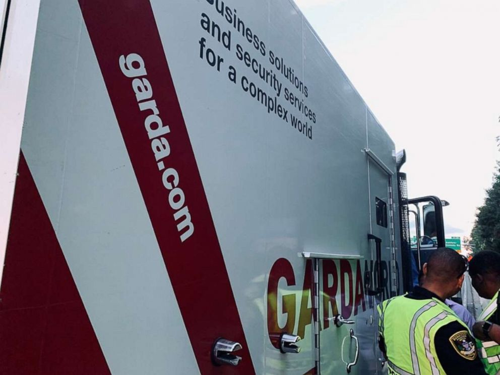 Drivers rush to grab cash after armored car's door flies