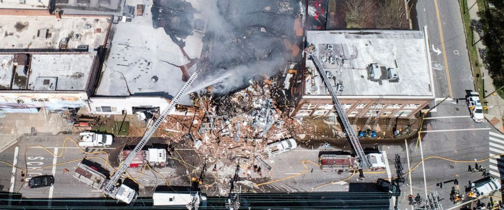 PHOTO: In this aerial photo, firefighters battle a fire at the scene of an explosion in Durham, N.C. Wednesday, April 10, 2019. (Julie Wall/The News & Observer via AP)