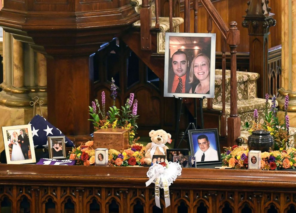 PHOTO: A unity urn with cremated ashes of Robert Joseph Dyson and Mary E. Dyson is set in place as friends and family prepare for a funeral mass at St. Stanislaus Roman Catholic Church in Amsterdam, N.Y., Oct. 13, 2018.
