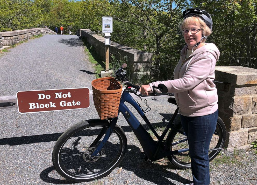 PHOTO: In this June 8, 2019 file photo, Janice Goodwin stands by her electric-assist bicycle at a gate near the start of the carriage path system where bikes such as her are banned inside Acadia National Park, in this photo June 8, 2018.